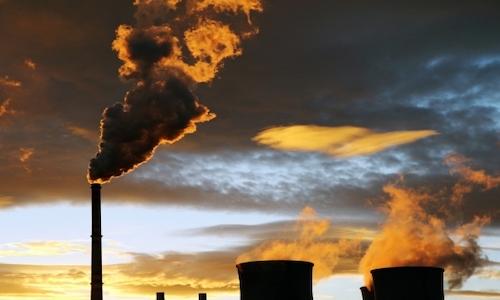 A refinery spouting smoke.